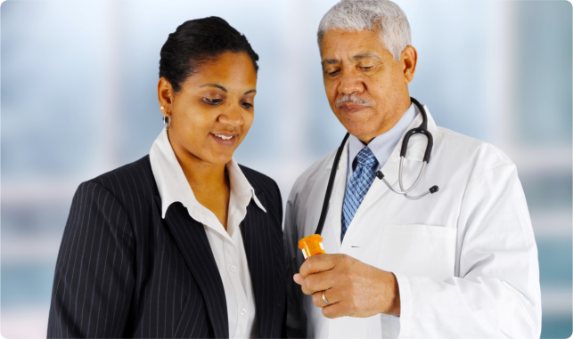 Portrait of a African American pharmacist holding out a med